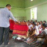 Secretary of DiYA Foundation introducing Rabha traditional designs to its weavers